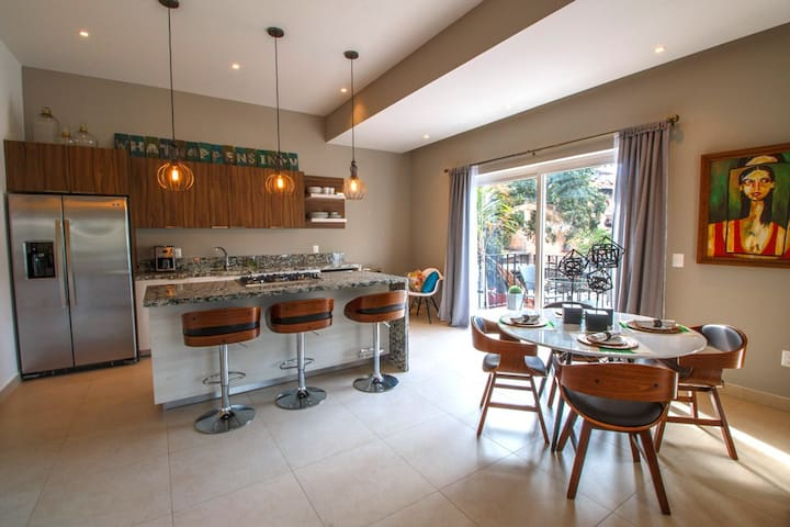 Designer Condo In The Romantic Zone | Pool, Gym, Walk to the Beach