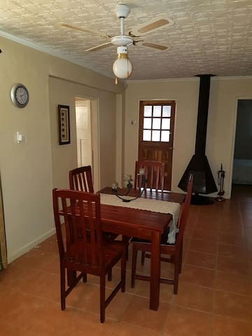 Dining area with jetmaster fireplace, perfect to warm up living space in winter!  Front door opens on to secure verandah.