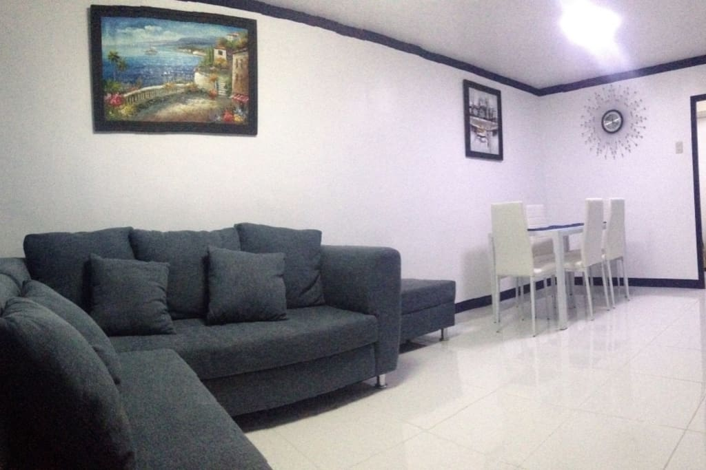 Great view of living and dining room with two paintings made by local artist. Call us at 09178506535