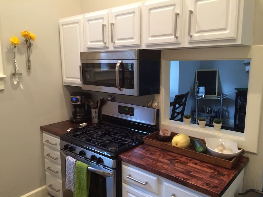 Full kitchen with beautiful butcher block counter tops!
