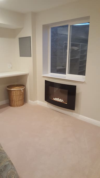 Electric Fireplace and Egress Window