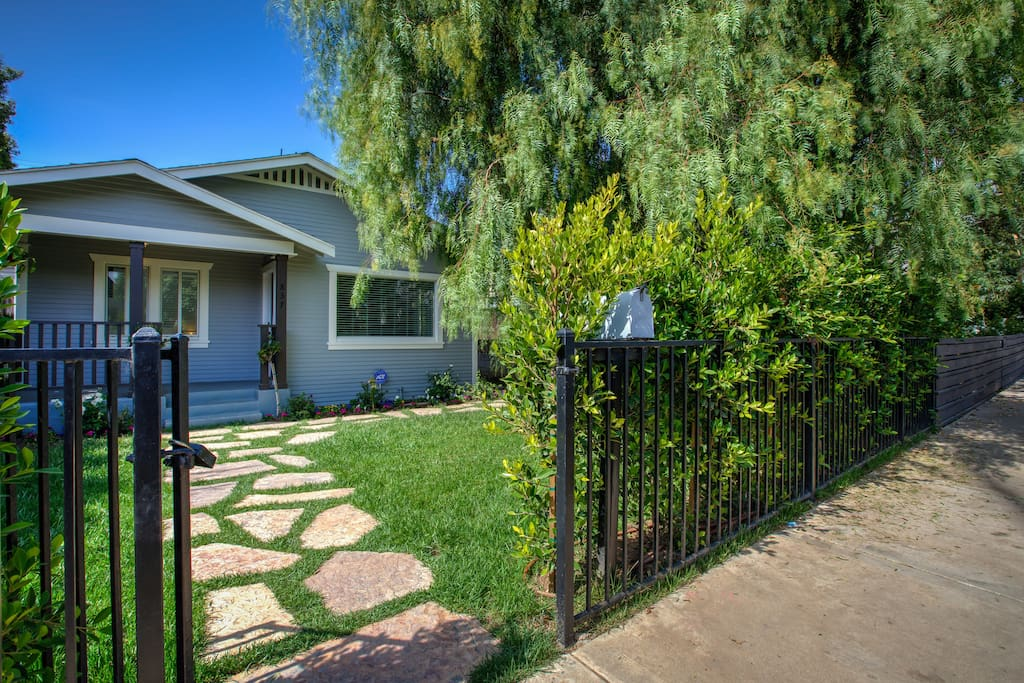 Seclusion and serenity behind a bank of ficus trees as you enter the property from this palm tree lined street