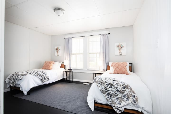 Bedroom 2 has two twin beds in a spacious room.