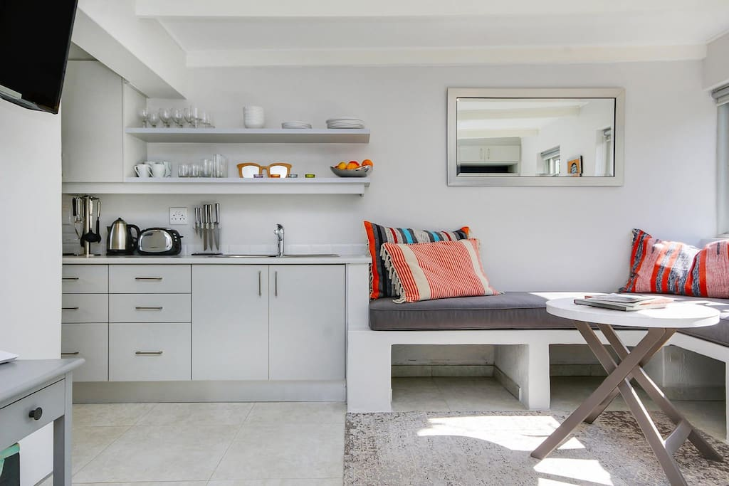 Kitchenette extends into banquette seating. Ideal for lounging around and dining.