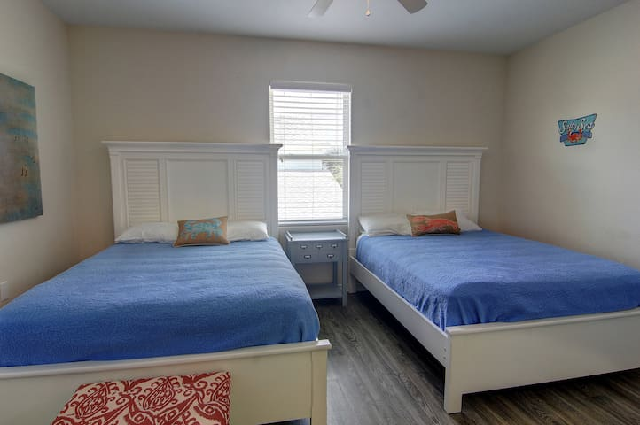 Upstairs third bedroom with 2 Queen beds and full ensuite bathroom.