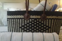 Beach bag provided with towels, sunscreen & paddle ball!