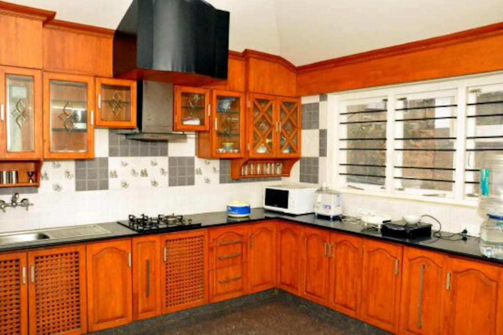 Fully equipped kitchen with Gas stove, induction, microwave, fridge, sandwich maker and cutlery