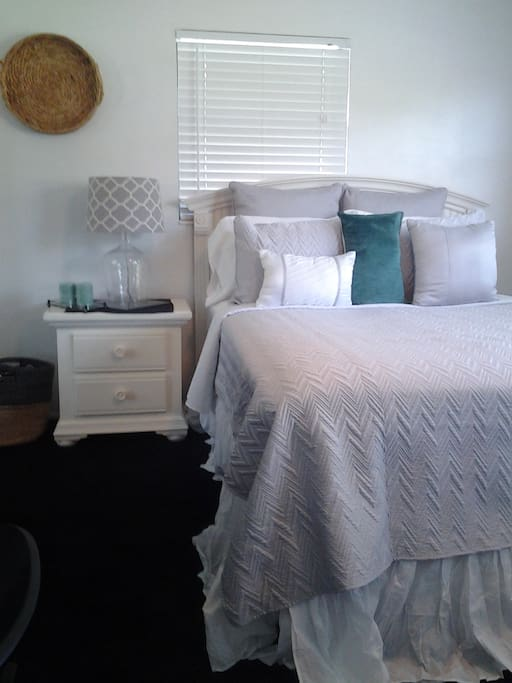Queen bed, side table & personal beach bag provided