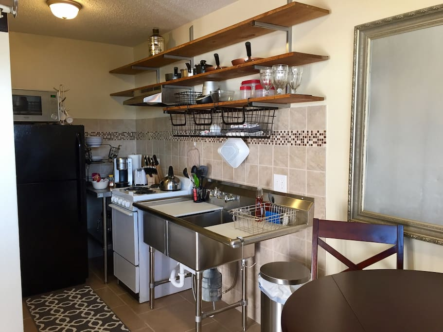 Open kitchen w/new stainless steel and tile