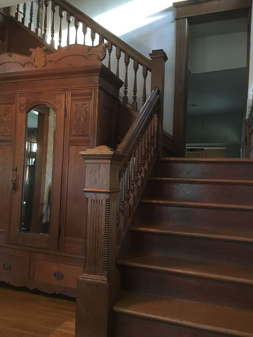Unique two-way staircase with original wood work.