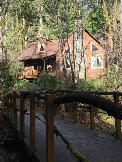 Cross the footbridge (over Hackett Creek) to reach the front door. Note: not ADA.