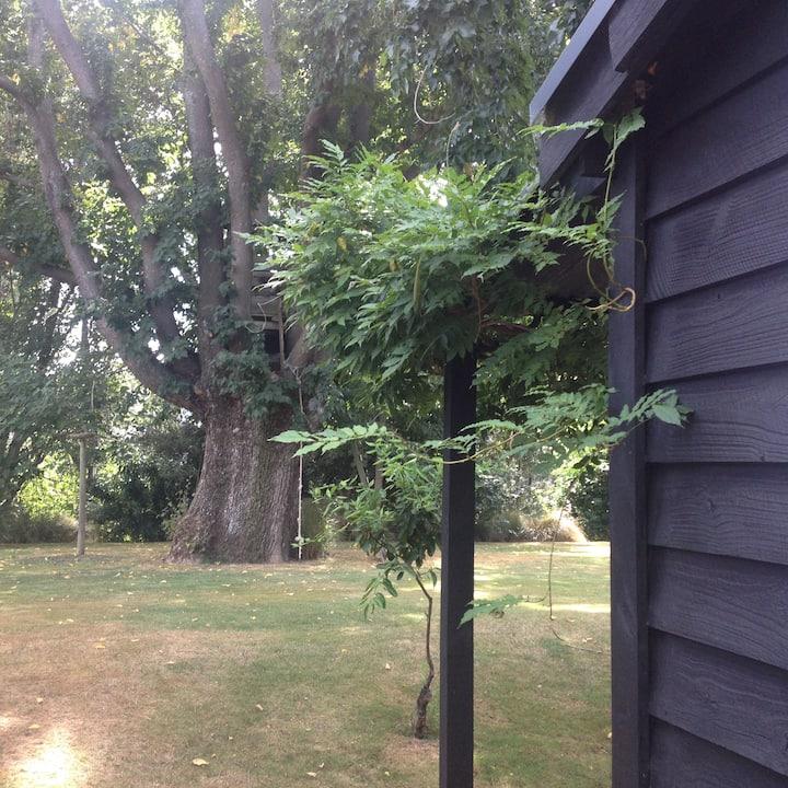 Private, riverside modern cottage.