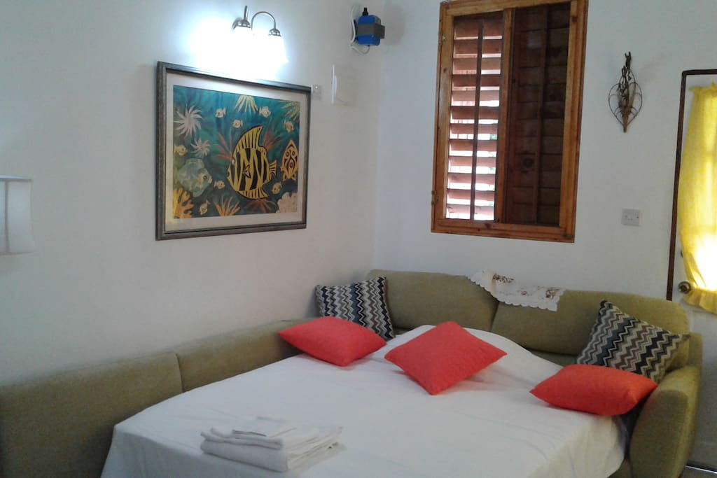 The sofa bed in the living room sleeps 2 comfortably, making the cottage ideal for 4 persons.