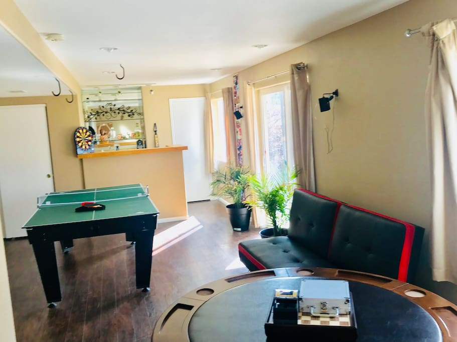 Basement has poker table, pool table, Bluetooth futon, bar with mini fridge, full bathroom, and color/strobing lights.  Perfect for entertaining!