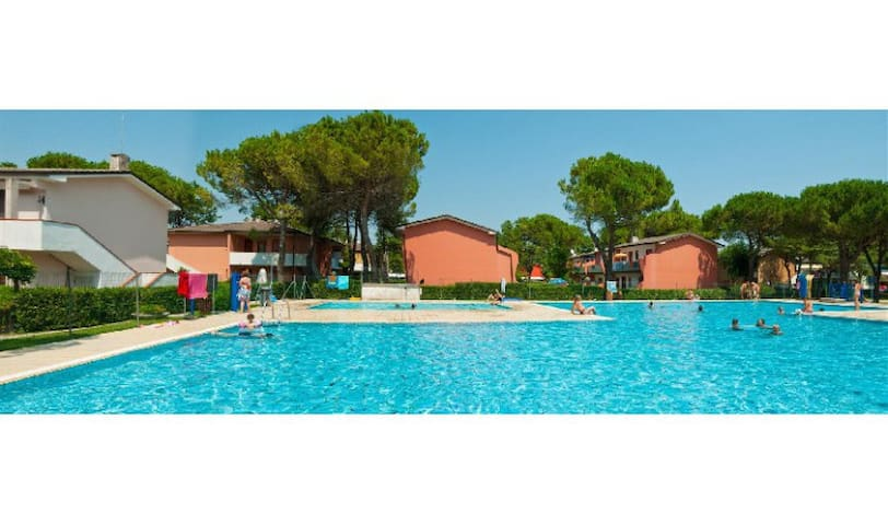 Quadrilocale con Giardino - Villaggio Azzurro - Bibione - Huis