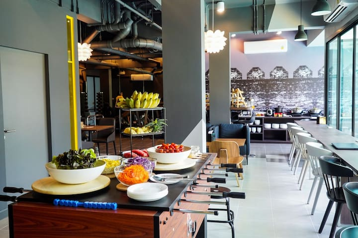 Dining area, with kitchen where your breakfast are whipped up with  fresh & healthy by resident chef.