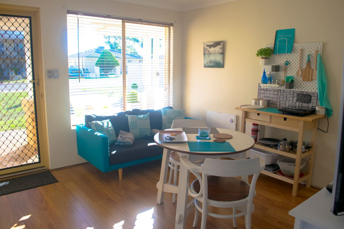 private living room with TV, kitchenette, fridge, microwave, kettle, toaster