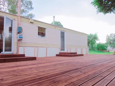 Glamping! Furnished Trailer House with Terrace