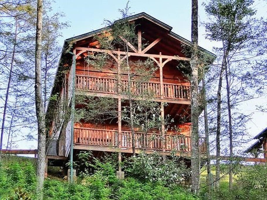 Two decks with rocking chairs - a hot tub on the lower deck and swing on the back upper dec
