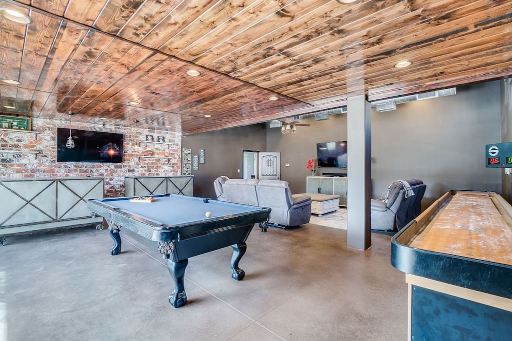 Awesome man den/game room with bar, pool table, 12' shuffleboard table, darts and more!