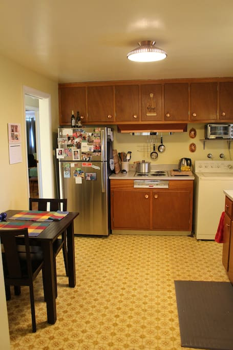Full-size refrigerator and freezer. Large sink and adequate counter-top space for preparing meals.