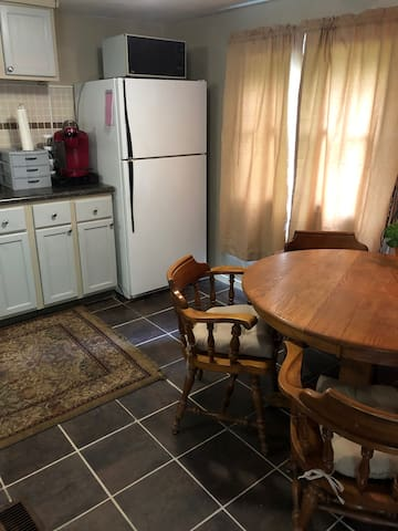 Kitchen with full refrigerator, Keurig coffee maker, microwave