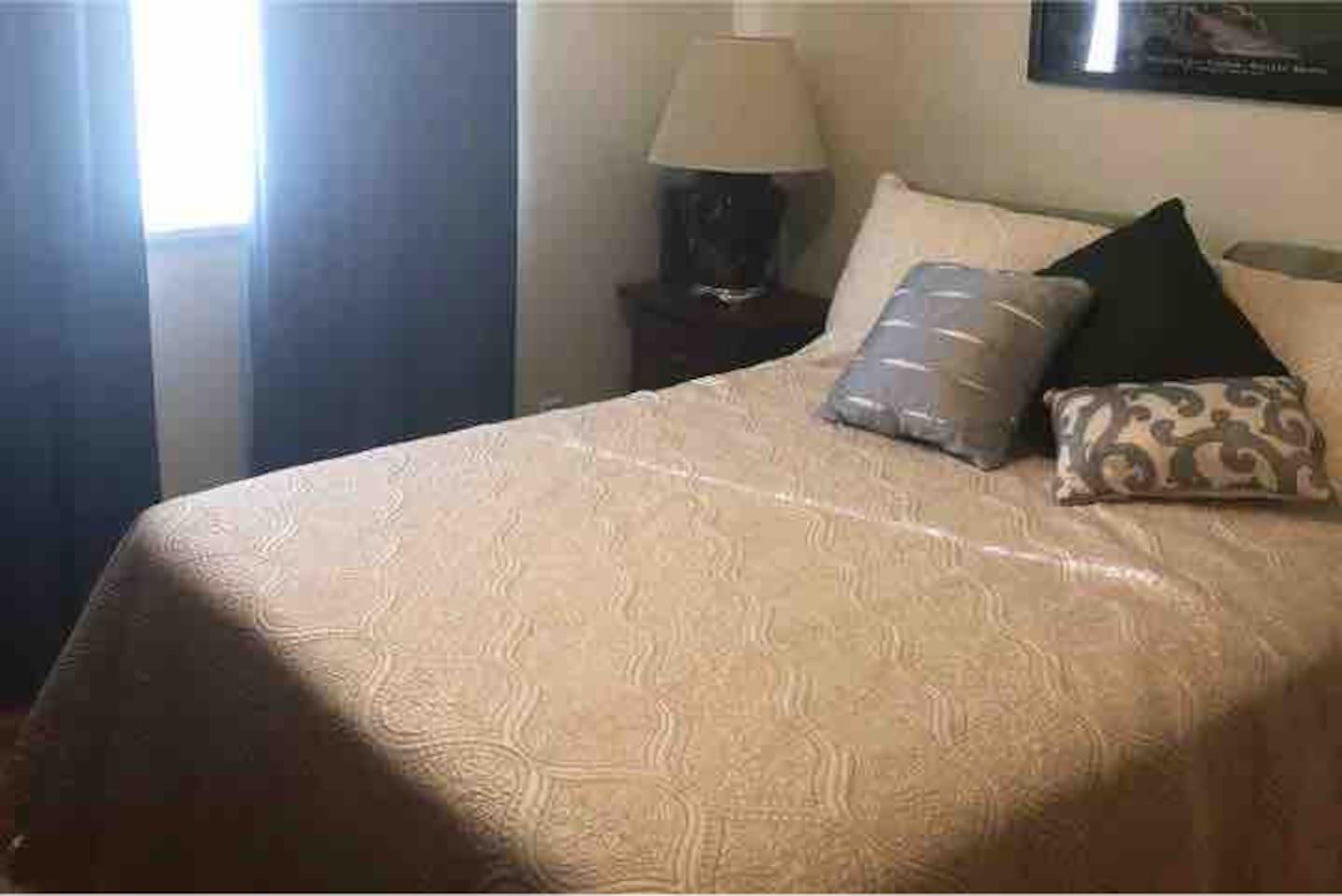 Full size memory foam mattress and plenty of pillows, dresser, nightstand, and closet.