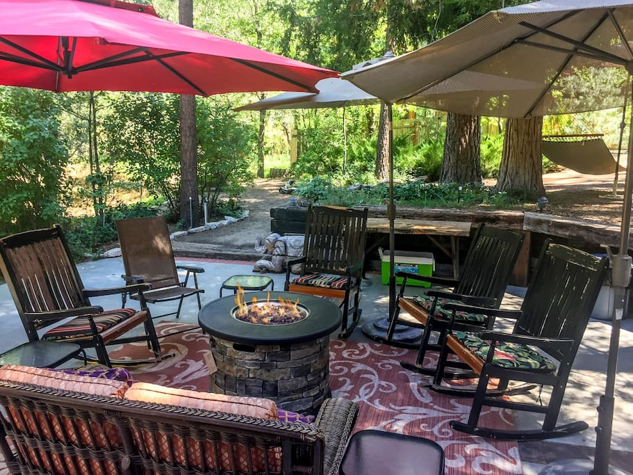 Look at this amazing 1/2 acre, lush yard!...and JUST ADDED! Safe and easy to use propane fire pit. Great for those cool evenings and chilly mornings.