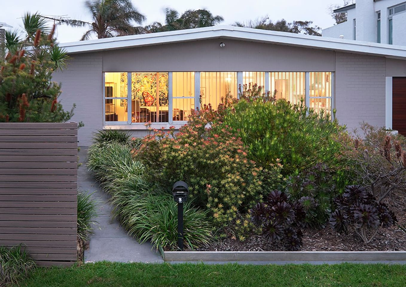 A light, bright 60's home across the road from the beach.