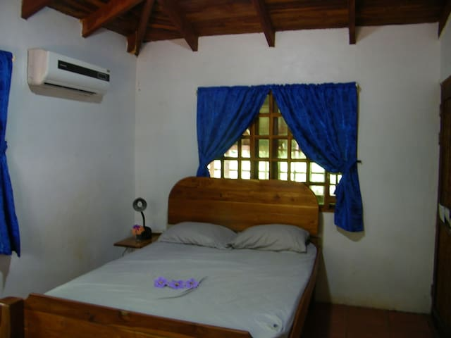 Main Bedroom with a double bed with air conditioning