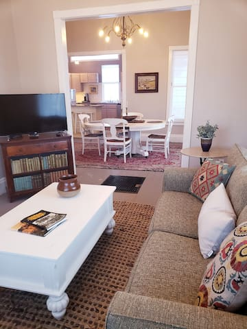 Roku Smart TV. View from  Living Room toward Dining Room & Kitchen.   Sofa opens up to a Queen sized bed