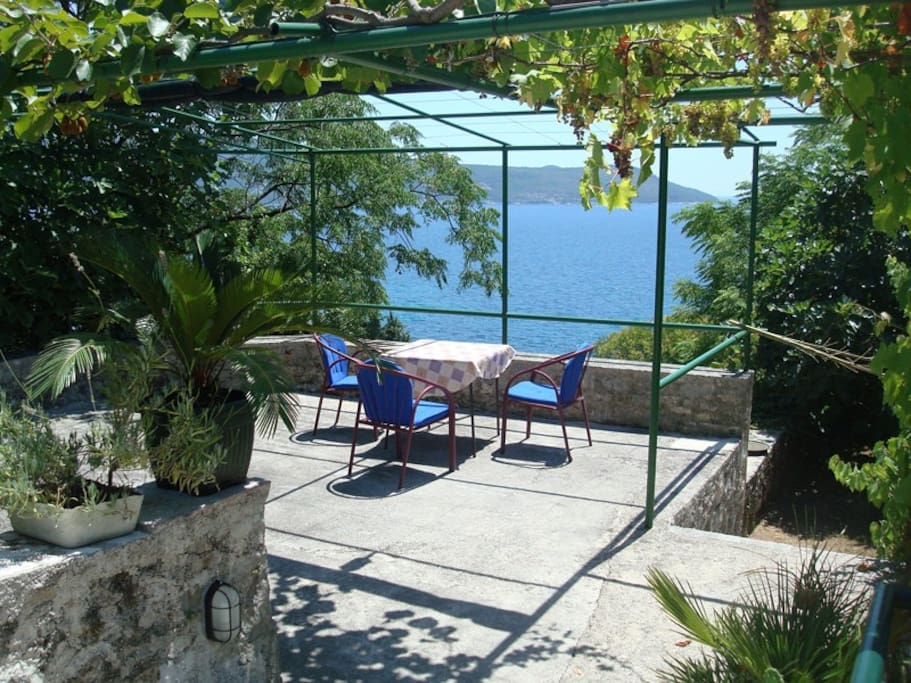 terrace with a sea view to the entrance to Boka bay
