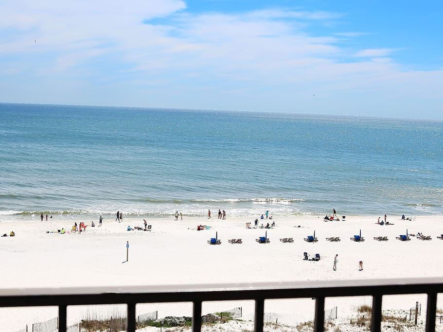 View of beach while sitting on balcony