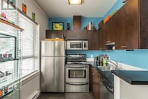 Stainless steel appliances, and plenty of storage/workspace.