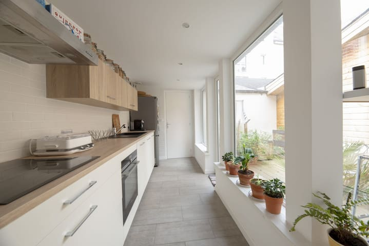 Bright, modern and wide fully equipped kitchen.