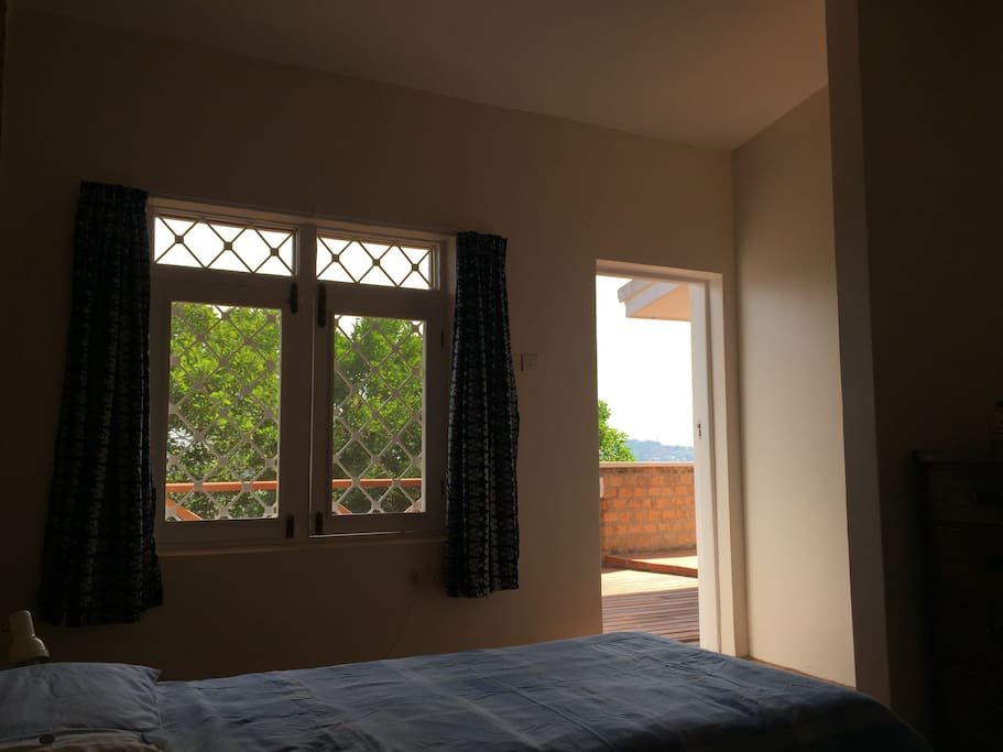Your room, with the door open onto the balcony