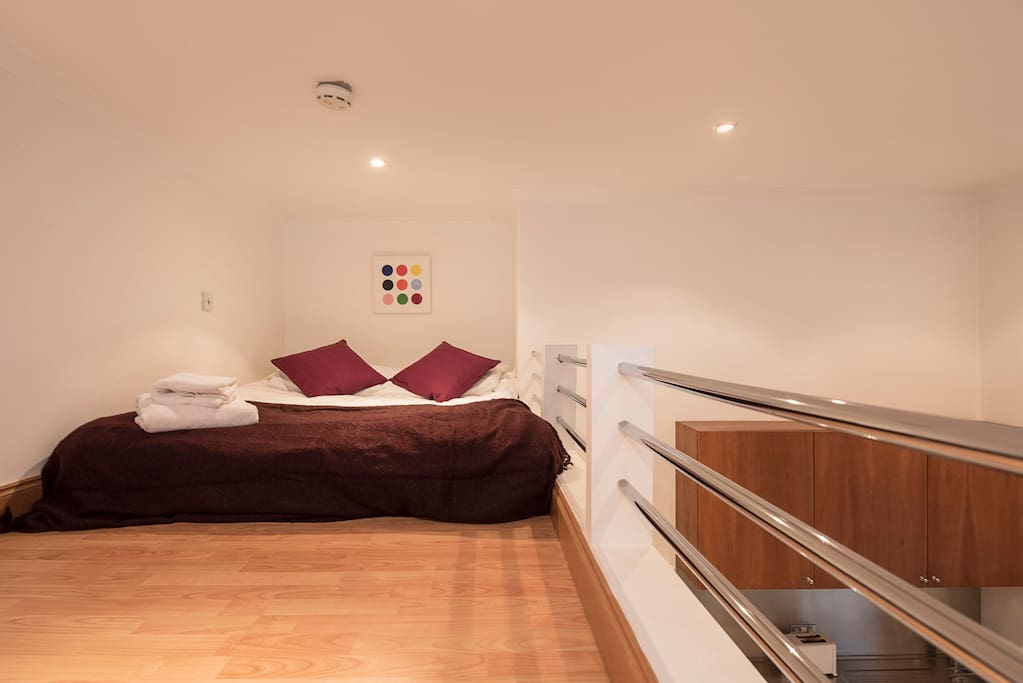 Double bed on mezzanine