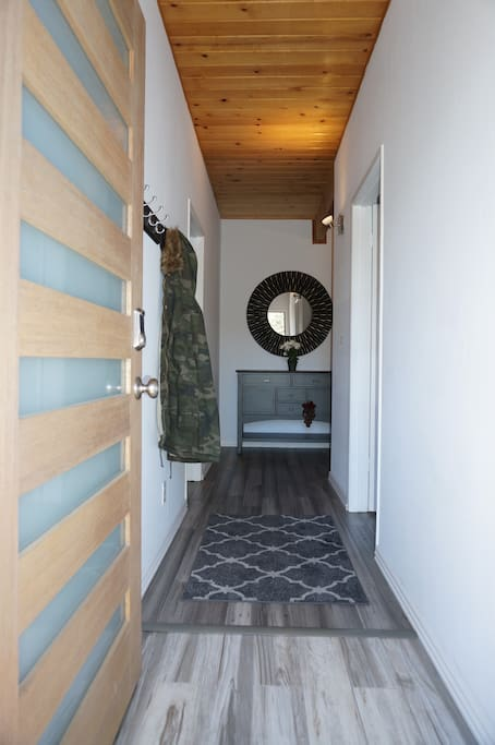Entranceway leading to new bamboo flooring throughout the bedrooms and common areas.