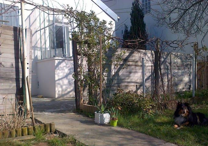 Chambre dans maison avec jardin proche de Paris