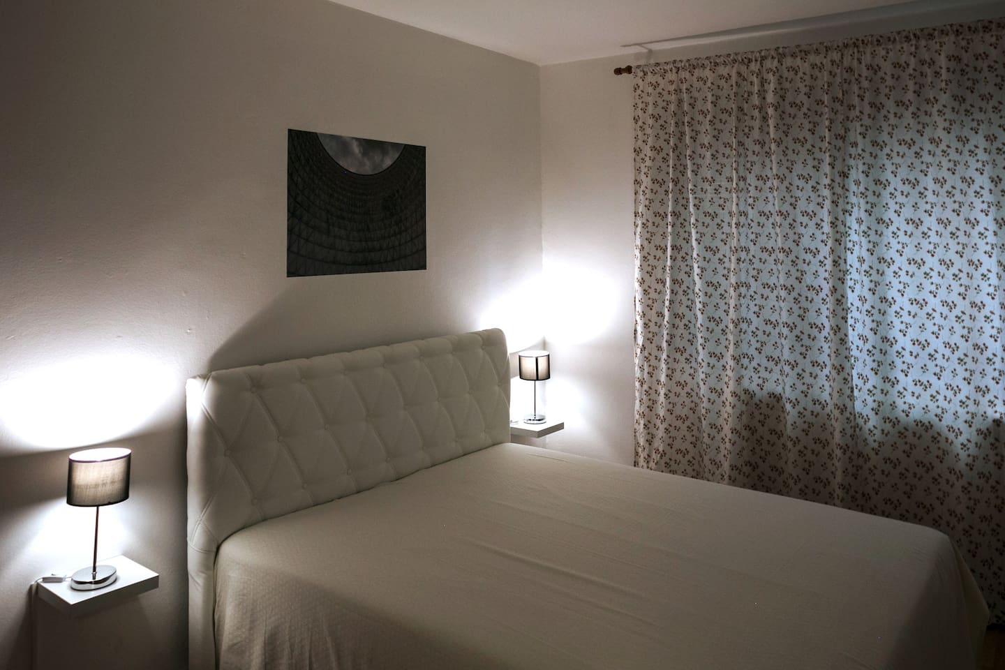 Detail of the master bedroom with full size double bed.