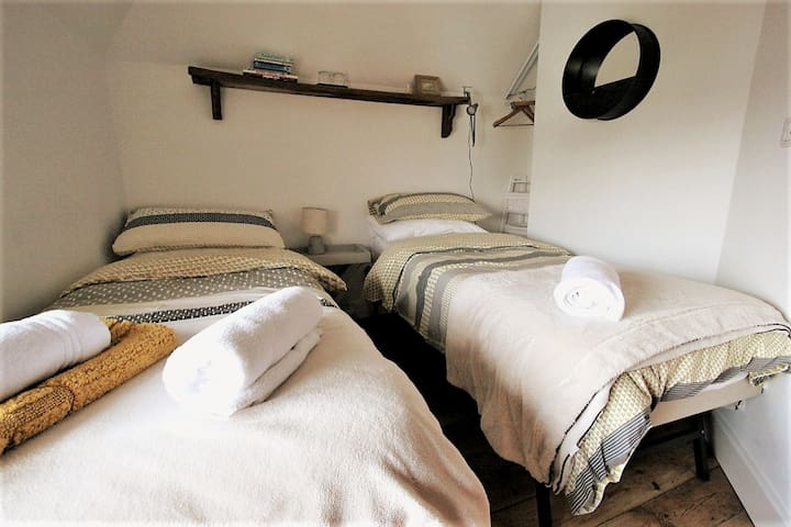 Lovely twin bedroom immaculately presented with Shower + Basin Room attached