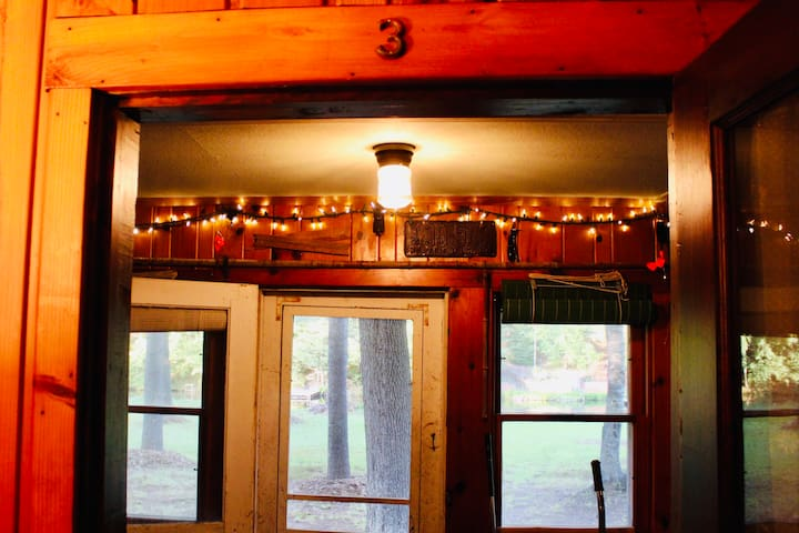 Main cabin Porch Suite door showing antique local hand made farm and fishing decor... along with some new stuff...
