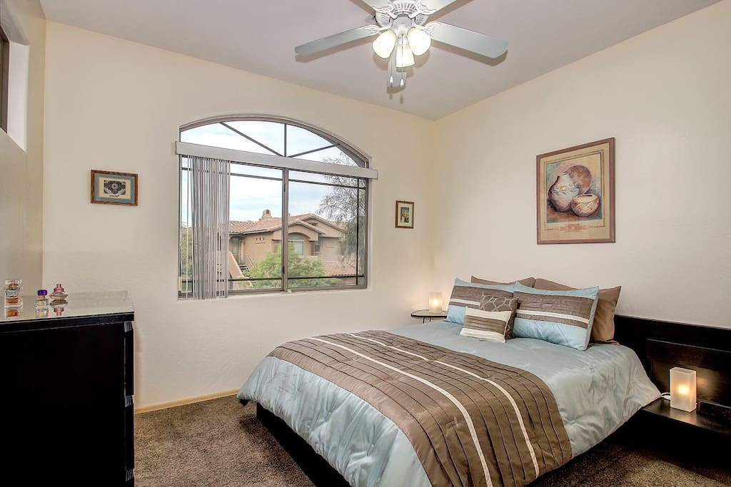 Queen bed with large closet, dresser and overhead fan