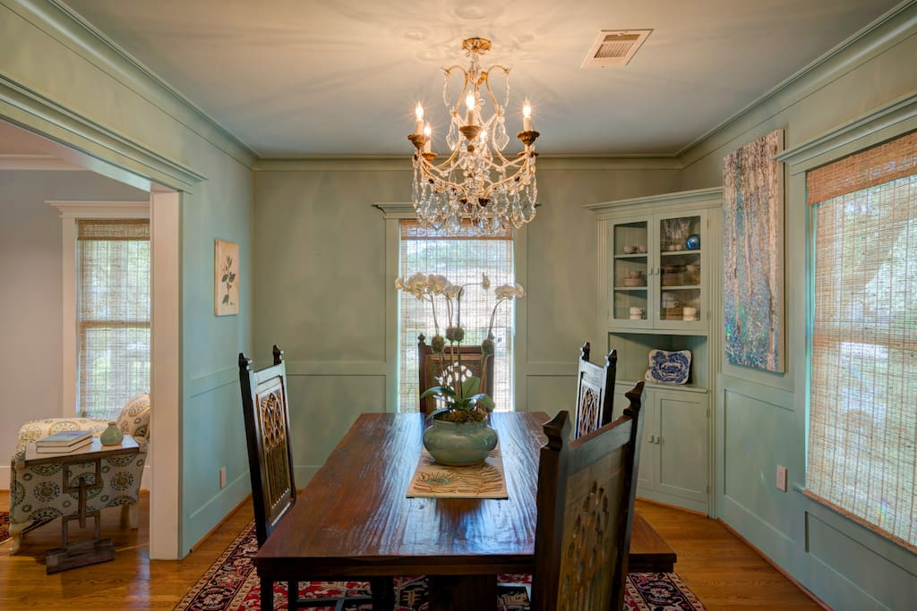 Dining Room with large trestle table and chandelier