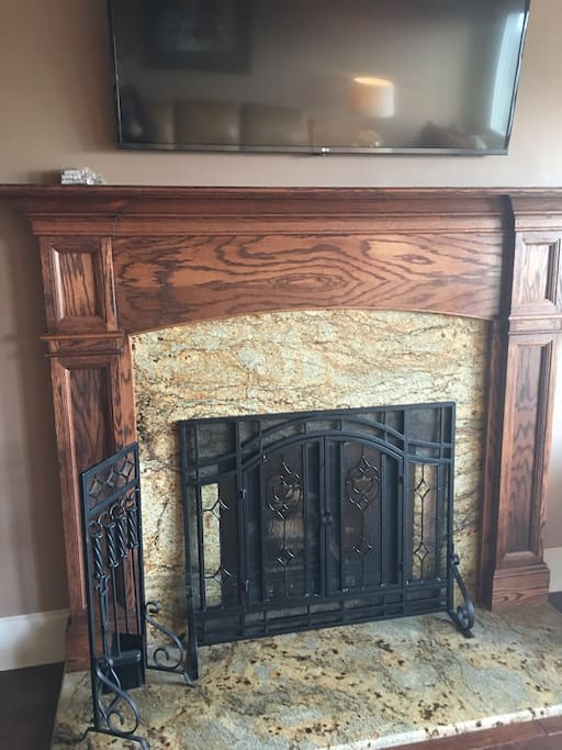 """Wood burning fireplace. Firewood is provided. 60"""" HD, Smart TV."""