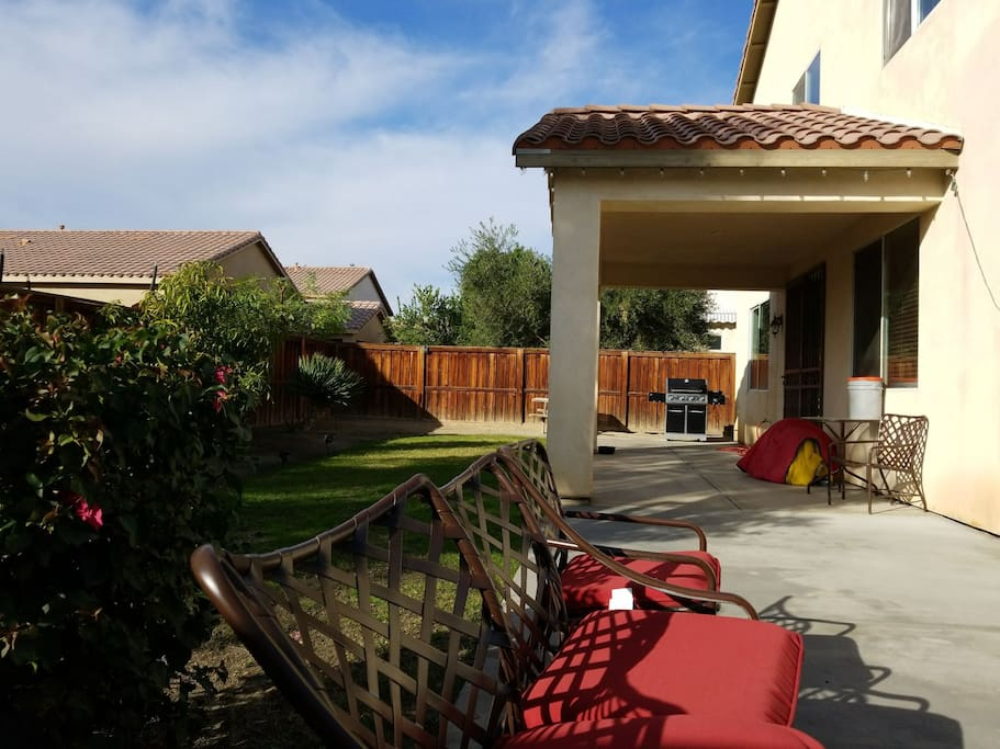 backyard seating area and barbecue grill.