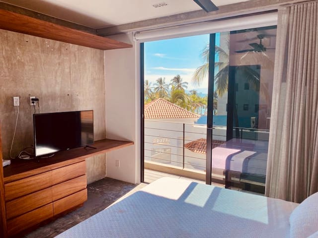 The Master Bedroom has a partial ocean view and a small balcony. As well as sliding doors, blackout blinds and polarized glass.