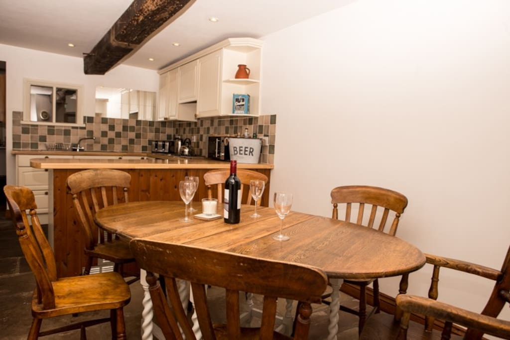 dining area with kitchen beyond
