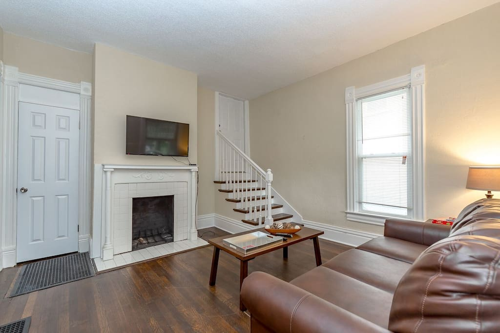 Perfect chill space as you walk into Holmes house.  Hearth, television, with lots of light and a beautiful space off one of the first floor bedrooms.