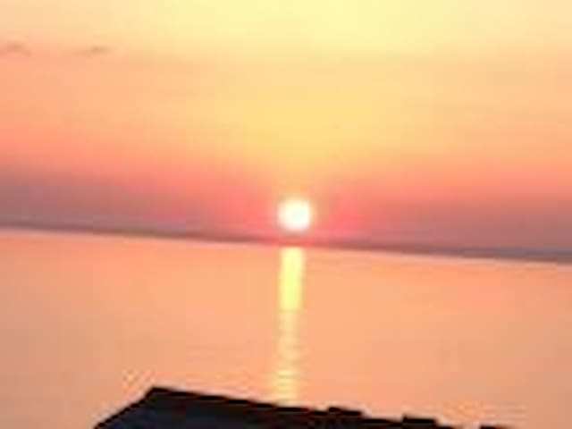 Spectacular sunsets seen from large balcony